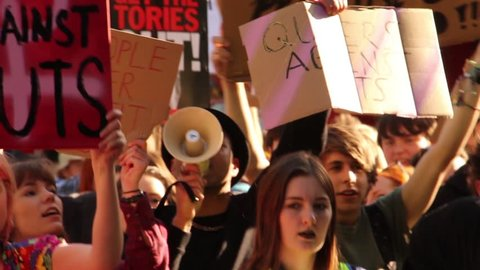 BRISTOL - May 13: Protest Against Conservative Government & Austerity: Young Man Chanting Through Megaphone on May 13, 2015 in Bristol, England.