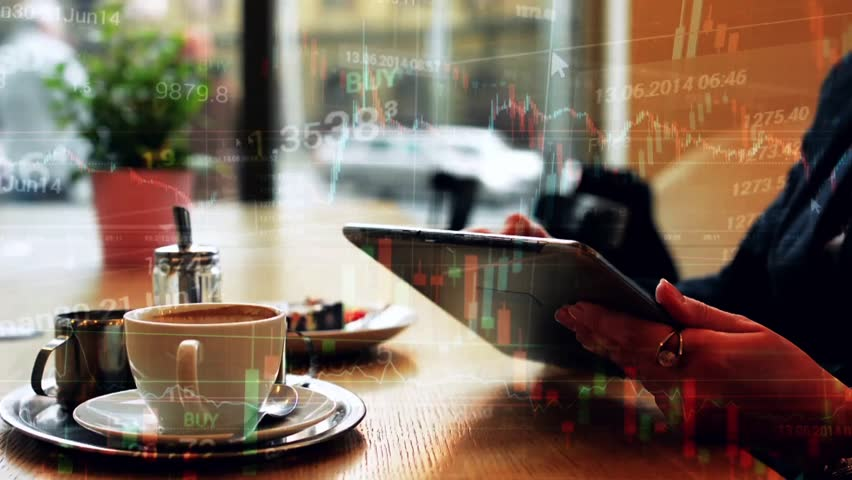 Woman works on tablet in cafe - financial market (exchange) - graph - closeup | Shutterstock HD Video #10015121