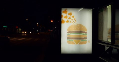 Paris, france - may 2015: mcdonald's updates its famously minimalist ads in  france to include emojis - zoom-in the big mac is made up of hundreds of  little thumbs-up signs as seen at a bus station