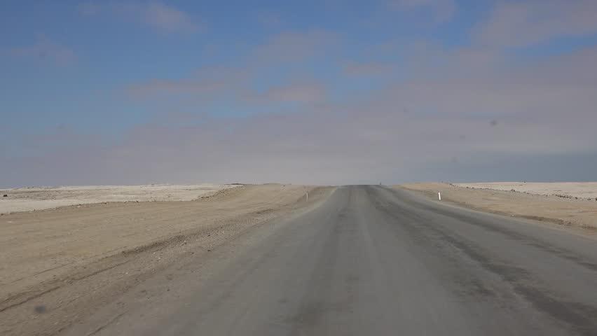 Driving through the Namibian Dessert
