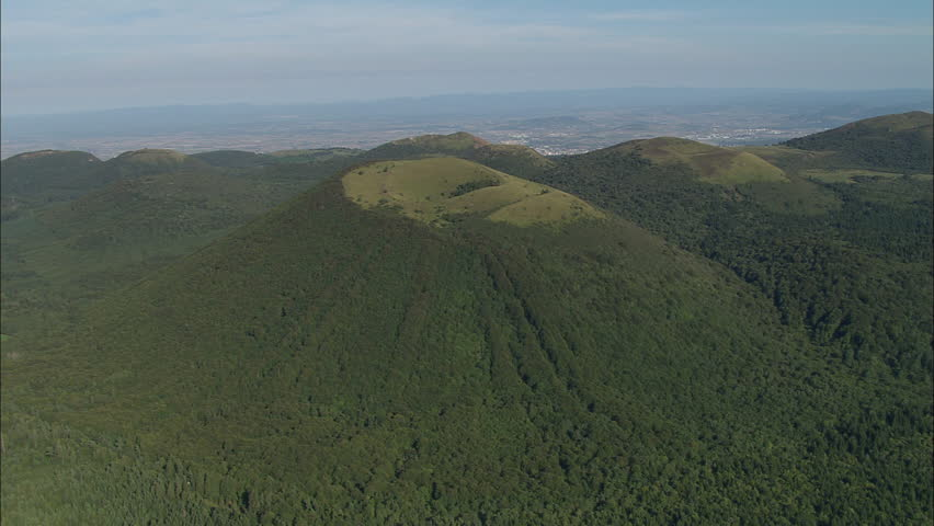 AERIAL France-Puy De Dome Area Of Old Volcanoes 2006: Volcanoes with wooded sides at Puy de Dome volcano region