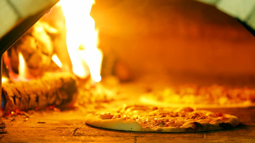 pizza baking in a wood fired oven