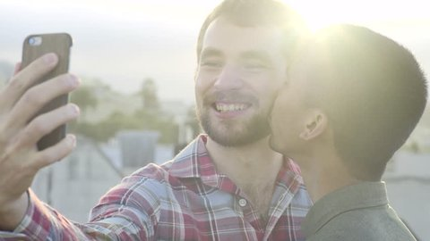 Cute Gay Couple Pose For Selfie With A Kiss On The Cheek, Shot In 4K