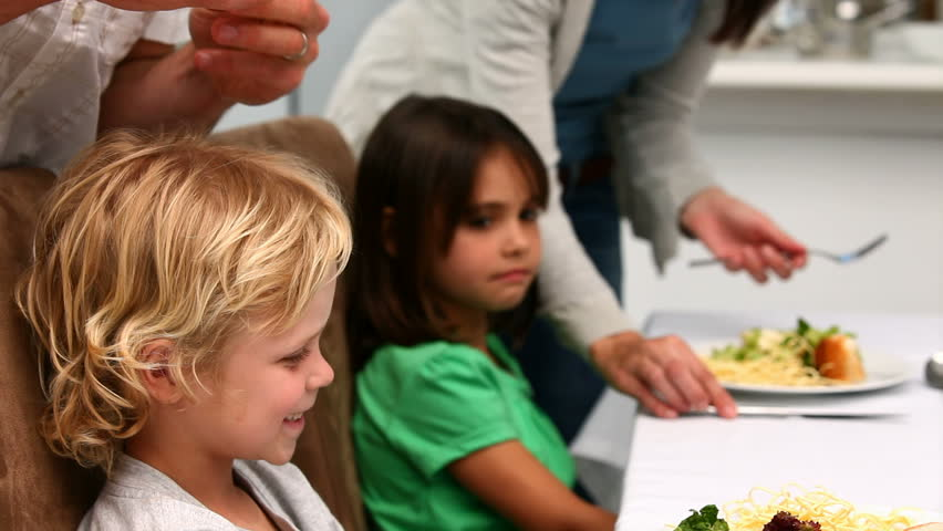 Parents trying to convince kids to eat in the kitchen   Shutterstock HD Video #1005151