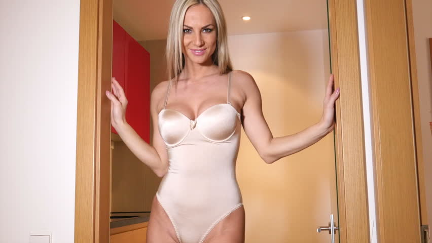 sexy mature blonde in lingerie acting sensual stock footage video