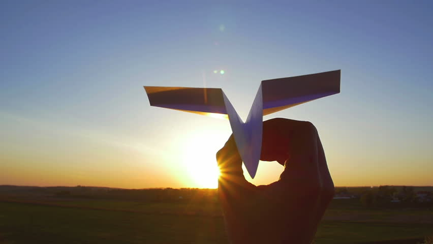 4 in 1 video! The hand hold paper airplane and launch by the bright sun and picturesque landscape background. 4x slow motion capture. Shot with Red Cinema Camera | Shutterstock HD Video #10054046