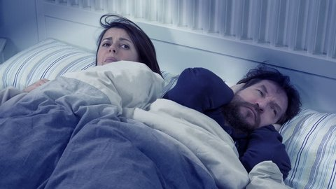 Happy wife and husband in bed in love playing laughing cute romantic