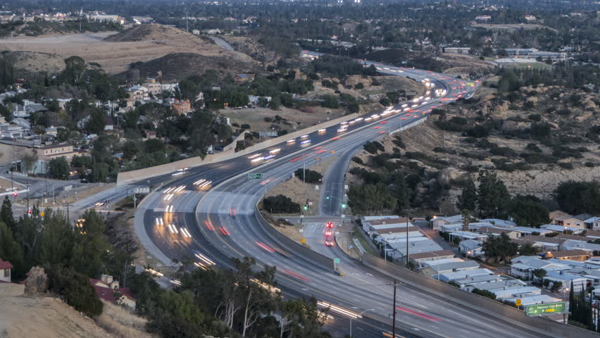 Dusk to night time lapse view of route 118 freeway and Topanga Canyon Bl in the San Fernando Valley area of Los Angeles, California.