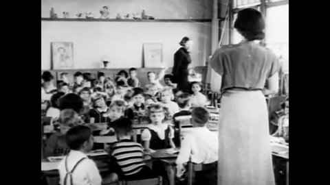 CIRCA 1951\xD1 A group of students learn in a classrooms and eat, and a cartoon turtle discusses the importance of ducking and covering.