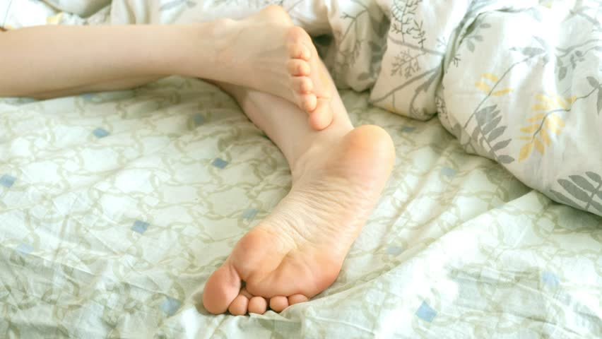 A loving husband wakes up his wife, funny tickles her feet 4k