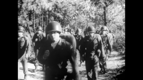 """CIRCA 1963 - Soldiers are heard singing """"The Battle Hymn of the Republic"""" as a hall of commemorative photos and military medals are shown."""