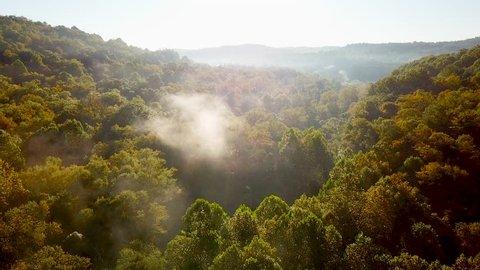 WEST VIRGINIA - CIRCA 2010s - Beautiful early morning aerial of fog in Appalachia West Virginia.