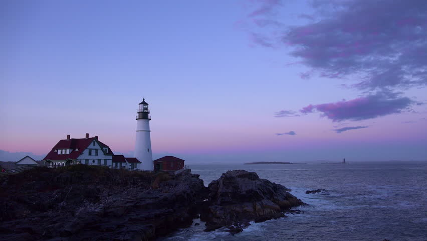 PORTLAND, MAINE - CIRCA 2010s - Establishing shot of the Portland Head Lighthouse in Portland, Maine at dusk.