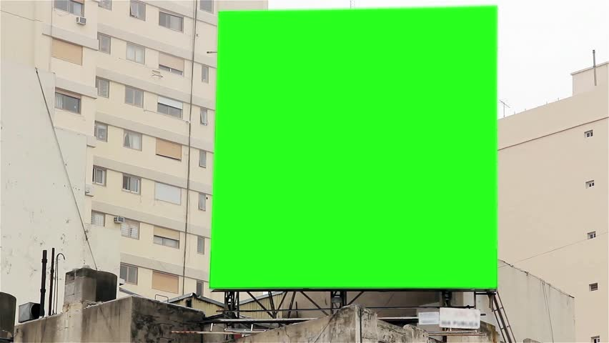"""Billboard with Green Screen on a Building. Ready to replace green screen with any footage or picture you want. You can do it with """"Keying"""" (Chroma Key) effect with your video editing software."""