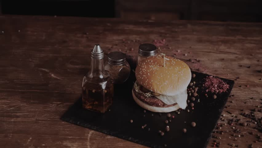 Close Up Of man Hands Taking Picture Of Three Burgers Sliders On Plate Using Smart Phone. Modern color grade. Close up