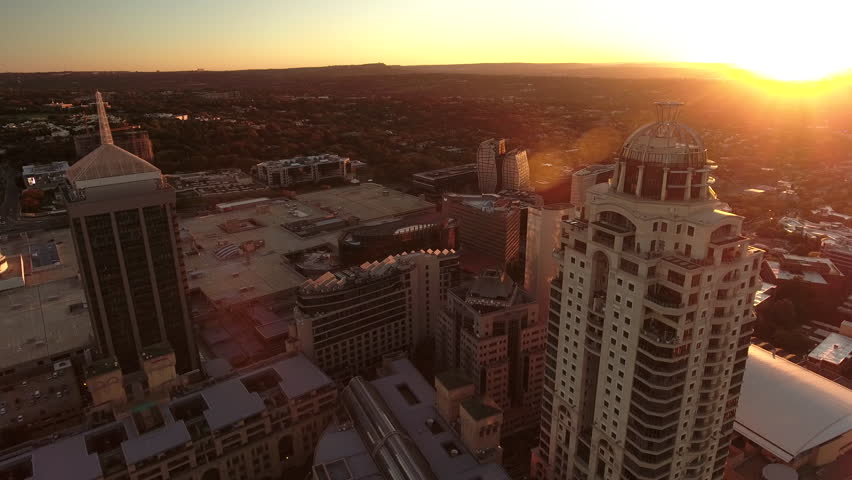 Drone flies above Sandton, Nelson Mandela Square, Johannesburg at sunset