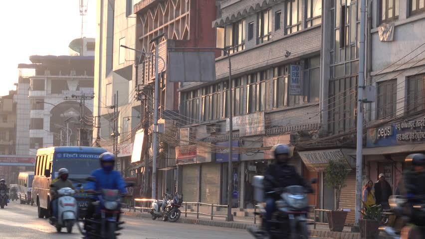 KATHMANDU, NEPAL - JAN 21: Traffic and pedestrians in the inner city at sunset on January 21, 2018 in Kathmandu, Nepal