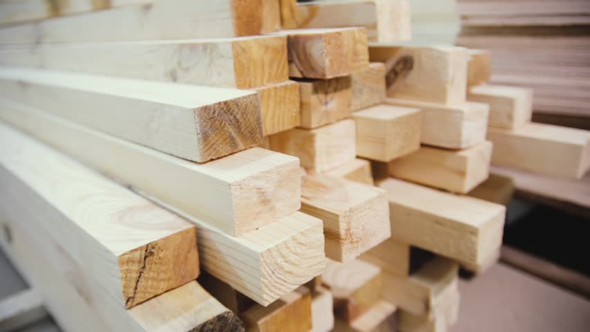 Wood factory stock and lumber board with nature business export. Stack of lumber wood in timber log storage. Wood processing joinery work wooden furniture. Wood timber construction material.