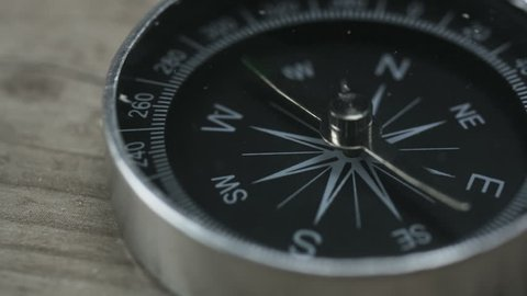 Close up shot of a spinning vintage compass