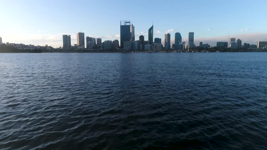 Drone aerial panning up over the Swan River towards Perth City