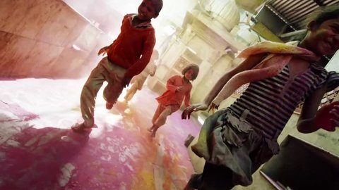 mumbai - india, october 2016. kids running in holi festival colors