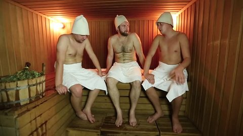men relaxing in the bath, sauna