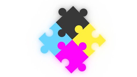 CMYK puzzle pieces. Graphic arts concept and metaphor of CMYK or four color print production process