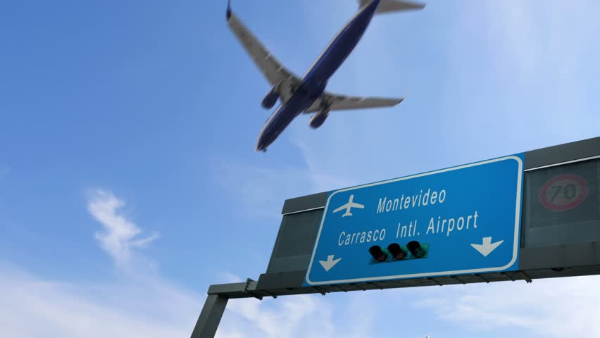 Airplane flying over montevideo airport signboard | Shutterstock HD Video #1006947811