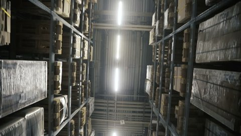 Moving camera along storehouse of goods in wholesale shop. Multi level modern warehouse. Dolly shoot