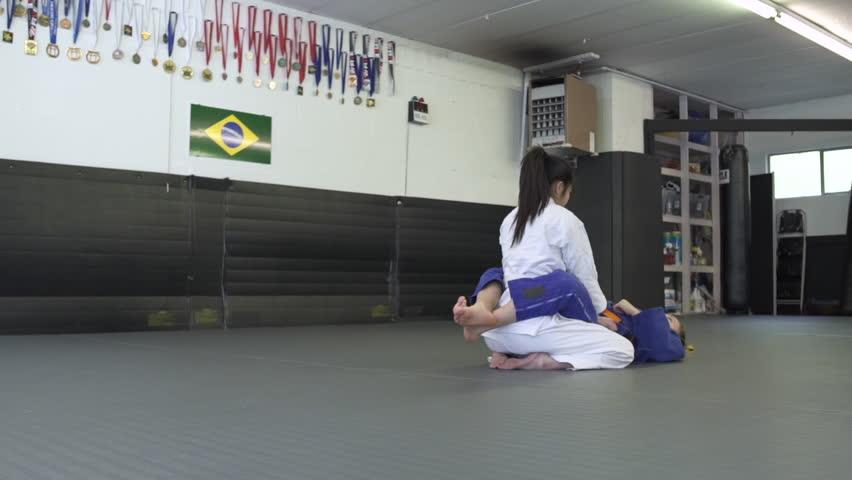 Teenage girls practicing Jiu-jitsu