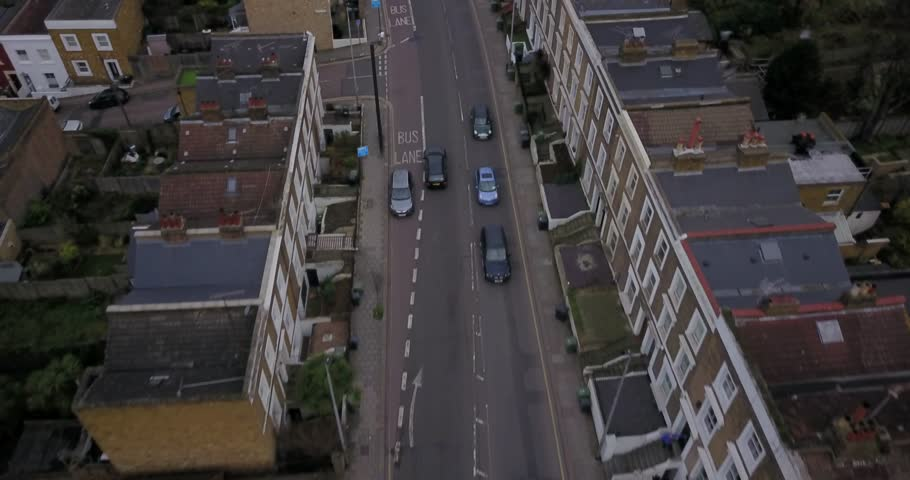 London, England, United Kingdom. Aerial Drone flight over busses and traffic on a bright sunny morning. | Shutterstock HD Video #1007038351