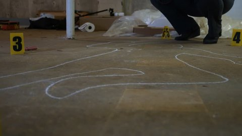 Sliding past a chalk outline at an active police crime scene for a homicide case