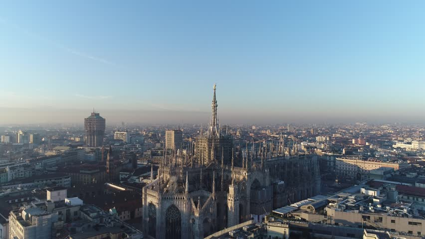Aerial drone footage of famous statue on cathedral Duomo in Milan Italy // no video editing