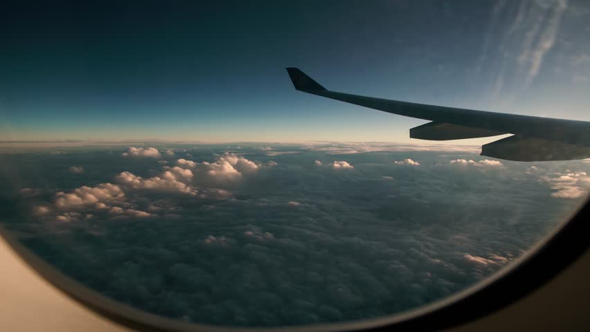 Aerial view from an airplane window, spectacular view of clouds
