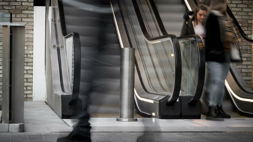 Time lapse of busy shoppers moving up and down a busy shopping centre escalator | Shutterstock HD Video #1007226091