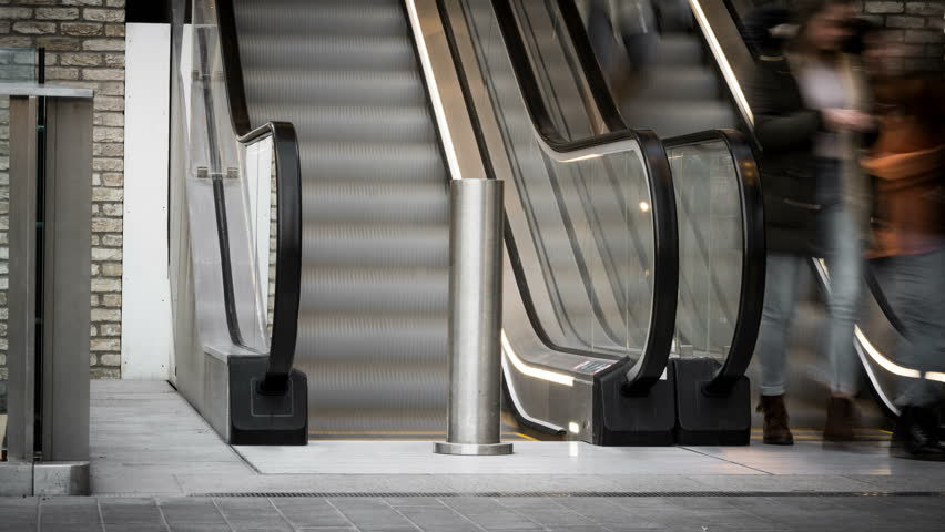 Time lapse of busy shoppers moving up and down a busy shopping centre escalator. Oxford, England | Shutterstock HD Video #1007226091
