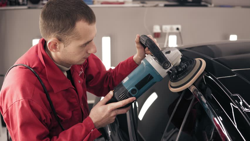 Cleaning the car's roofwith a professional mashine.   Shutterstock HD Video #1007246461