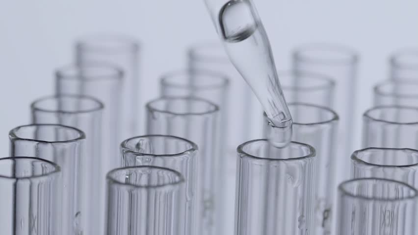 Laboratory scientist working with a pipette analyzes and extract the DNA or molecules in the test tubes.on white background   Shutterstock HD Video #1007352541