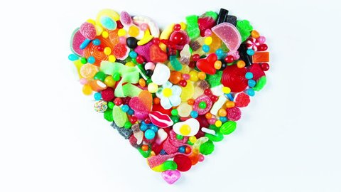 a large collection of sweets and candy made into a heart shape