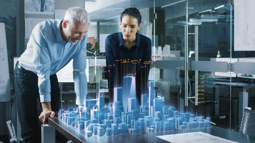 Male and Female Architects Work with Holographic Augmented Reality 3D City Model. Technologically Advanced Office Professional People Use Virtual Reality Modeling Software Application.