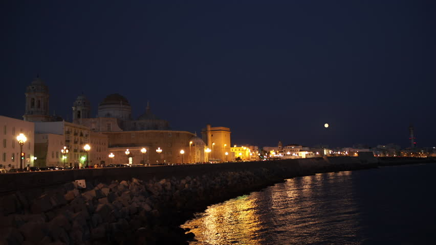 Night view of Cathedral and ocean coast in Cadiz. Andalusia, Spain