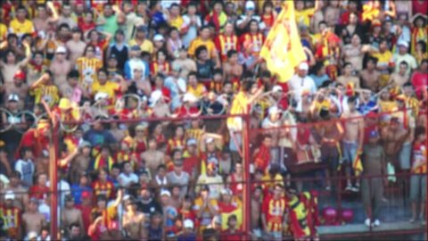Blurred Crowd of People, Supporters and Fans in a Stadium Tribune at a Football Match in Argentina.