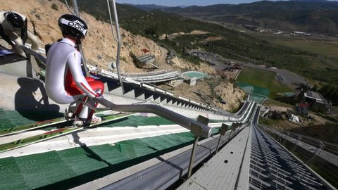 Park City, Utah, July 2015.  Junior nordic ski jumpers train at Utah Olympic Park in summer on K90 jump, venue for the 2002 Olympic Winter Games.