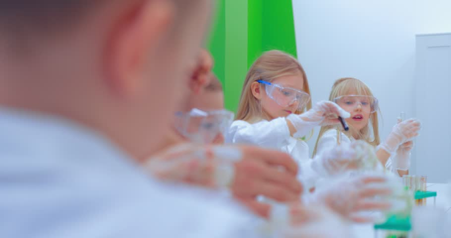 Teacher and students doing science experiment in school classroom. Children in chemistry class | Shutterstock HD Video #1007594161