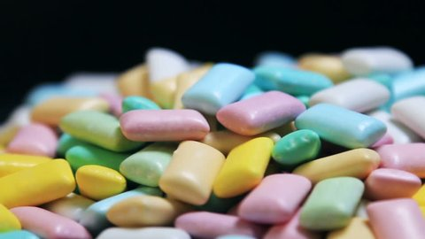 different colors chewing gum pastel color. Background. The video rotation