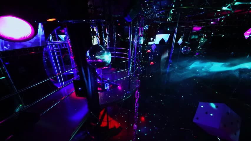 MOSCOW - DEC 09, 2016: Interior of White Bear striptease club with colorful  illumination and smoke