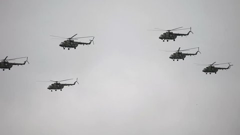 Helicopter on cloudy sky background. Military equipment.