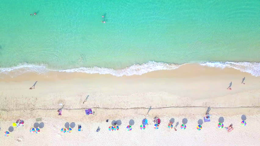 Aerial top view Surin Beach in Phuket, Thailand, southern of Thailand, Surin beach is a very famous tourist destination in Phuket, 4k aerial view beach.
