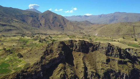 Incredible view of the Andes Mountains from a drone flying above the Colca Canyon Valley in Peru
