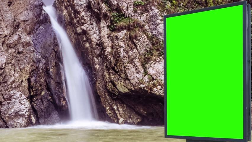 Billboard green screen near the Fabulous waterfall   Shutterstock HD Video #1007703985